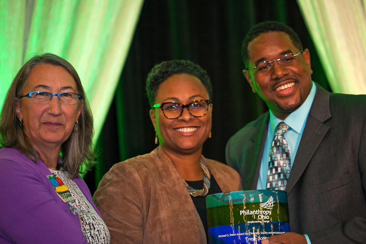 Treye Johnson (right) won the 2017 Michael G. Shinn Award for Diversity, Equity and Inclusion in Philanthropy. He's pictured with Athens County Foundation Executive Director Susan Urano (left) and Deborah Aubert Thomas, Philanthropy Ohio vice president for programs and learning.