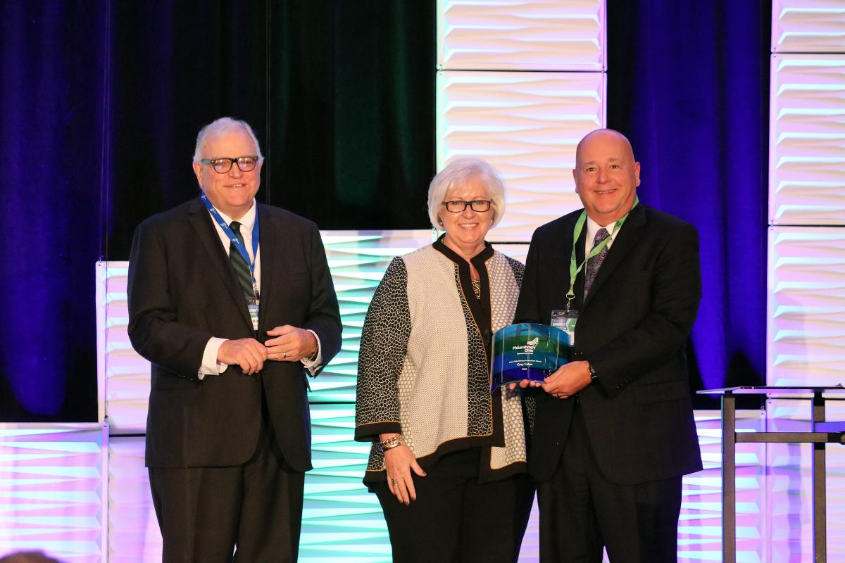 Robert Jaquay, associate director for The George Gund Foundation; and Suzanne Allen, president & CEO for Philanthropy Ohio; present the Philanthropy Innovation Award to Gary Cates, chief philanthropy officer for ProMedica Health System.