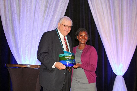 Aiyana Marcus, program officer at The Dayton Foundation, accepted the Innovation Award on Don's behalf and is pictured with Robert Jaquay, The George Gund Foundation associate director.